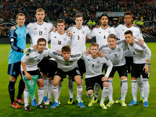 FILE - In this Oct 11, 2013 file photo, Germany soccer team poses prior to the start the World Cup Group C qualifying soccer match between Germany and Ireland in Cologne, Germany. Background from left: Manuel Neuer, Per Mertesacker, Toni Kroos. Marcell Jansen, Sami Khedira and Jerome Boateng. Foreground from left: Philipp Lahm, Thomas Mueller, Andre Schuerrle, Bastian Schweinsteiger and Mesut Ozil. (AP Photo/Michael Probst, File) - SEE FURTHER WORLD CUP CONTENT AT APIMAGES.COM