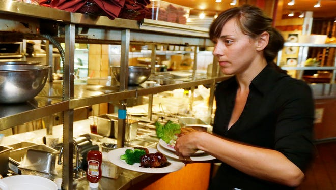 Some restaurants are limiting workers' hours to minimize the impact of the new health coverage requirement..