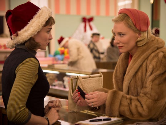 Therese (Rooney Mara, left) falls under Carol's (Cate