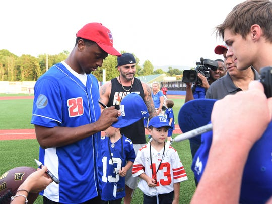 New York Giant Eli Apple signs autographs before a charity softball game at Dutchess Stadium on Monday.
