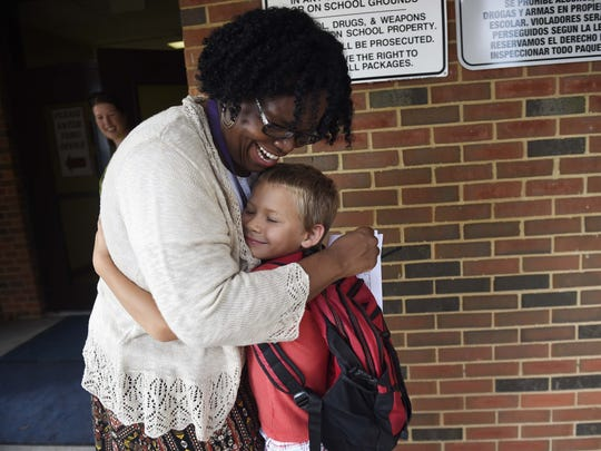 Principal Dr. Cheryl Robey hugs first-grader Gary Swafford on the first day of school at Liberty Elementary Aug. 5, 2016 in Franklin, Tenn.
