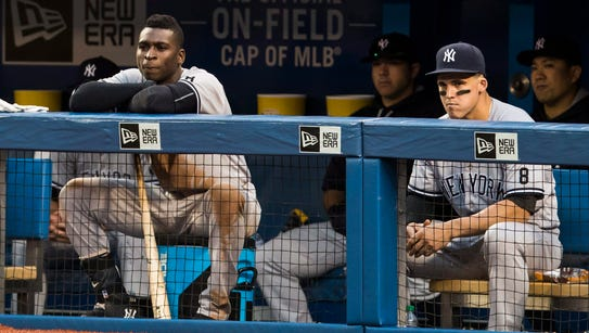 New York Yankees' Didi Gregorius, left, and Tyler Austin,