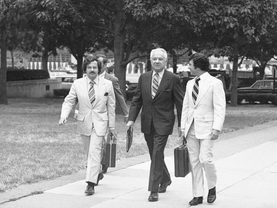 Attorney Philip Lacovara, left, walks with Special