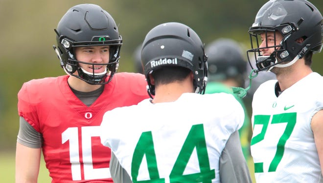 Apr 21, 2017; Eugene, OR, USA; Oregon Ducks quarterback Justin Herbert (10) and tight end Matt Mariota (44) and tight end Jacob Breeland (27) talk during spring practice at the Oregon Ducks outdoor practice facility. Mandatory Credit: Scott Olmos-USA TODAY Sports
