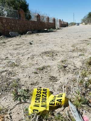 Police tape is left on the ground after  Jose Lopez Perez, 33, who was killed during an alleged altercation in Dona Ana on Tuesday night at a residence located on Rocca Secca Road.