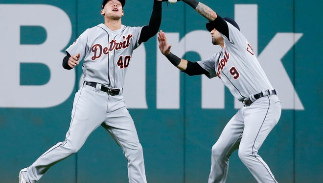 Tigers centerfielder JaCoby Jones (40) and rightfielder Nick Castellanos (9) collide going for a ball hit by Indians designated hitter Edwin Encarnacion during the fourth inning on Monday, Sept. 11, 2017, in Cleveland. Jones was charged with an error on the play.
