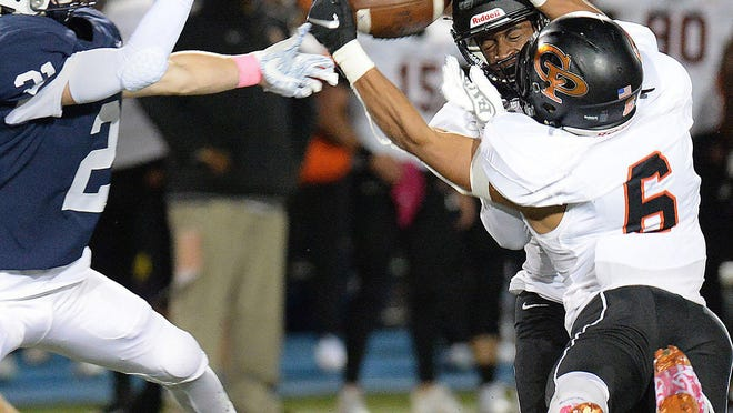 This pass intended for McDowell's Damon Berarducci, left, was broken up by Cathedral Prep defenders, including junior X'Zonder Goodwin (6), at Gus Anderson Field on Oct. 4, 2019. Football players and other athletes from other Pennsylvania fall high school sports will find out Friday if there will be a fall sports season.