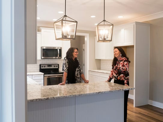"""Laura Slyman, KAAR president and principal broker for Slyman Real Estate, right, talks with Slyman Real Estate realtor Susy Yeatman inside a new home at The Cove subdivision off Keller Bend Road. on Wednesday, February 28, 2018. """"""""What we're continuing to see this year is that it's still a very, very strong seller's market,"""" said Slyman."""