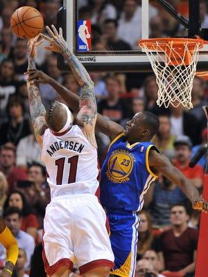Warriors forward Draymond Green blocks Heat center Chris Andersen in Thursday's 123-114 road win.