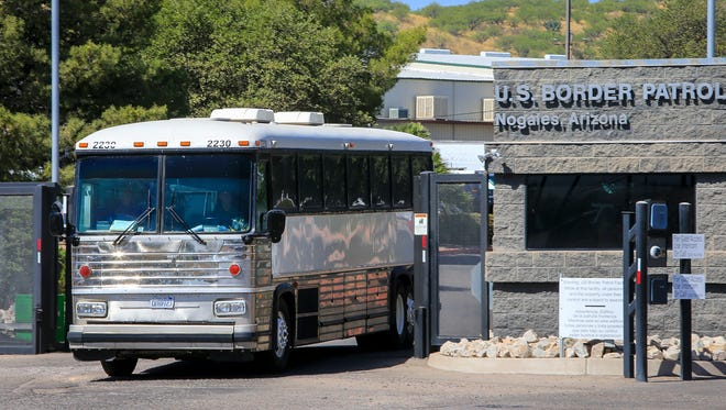 A bus leaves the U.S. Customs and Border Patrol facility in Nogales, Ariz., on June 9, 2014.