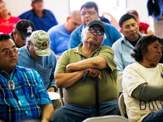 Peterson Bell, center, 58, who has diabetes, arthritis and vision impairment, sits and listens during a community meeting to take public testimony for a measure that could enable new uranium mining in the Church Rock, N.M., area at the chapter hall in Church Rock, N.M., on the Navajo Reservation on May 28. The area has numerous abandoned uranium mines that have never been cleaned up.