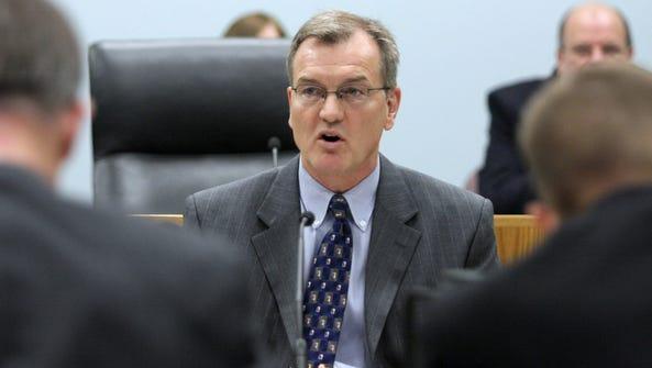 Iowa Utilities Board chairman John Norris speaks during