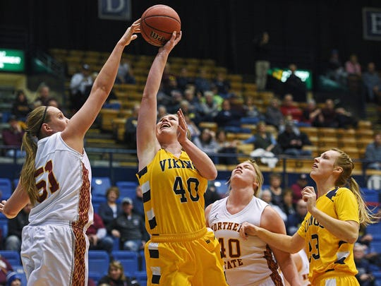 A shot by Augustana's Shelby Selland (40) is blocked