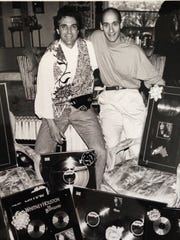 "Writing Whitney Houston's ""Run to You"" for ""The Bodyguard"" soundtrack brought a great deal of recognition for Jud Friedman (left) and Allan Rich, shown here with numerous plaques the song and album received."