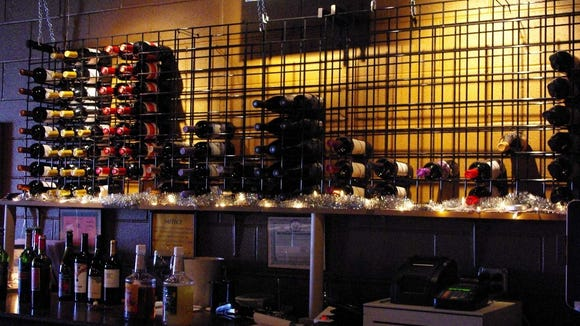 Some of the Vino Lounge's wines on display behind