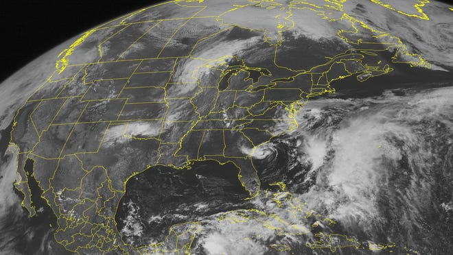 This NOAA satellite image taken May 20, 2012, shows Tropical Storm Alberto, spinning about 95 miles southeast of Savannah, Ga. A report released by business leaders warns of economic losses from stronger hurricanes, fueled by global warming.
