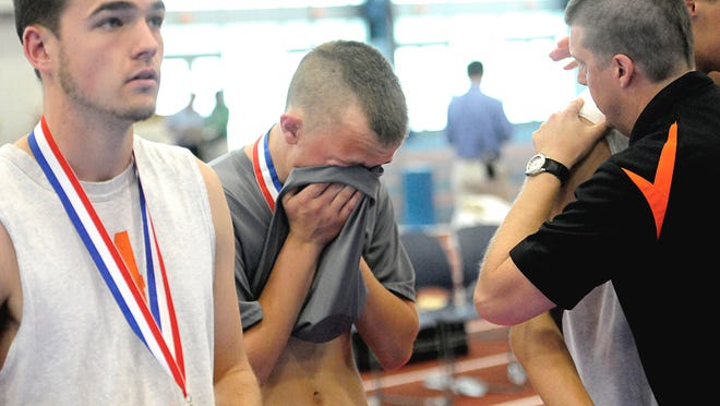 York Suburban senior Justin Corsa, center, and teammates become emotional after falling to Bethlehem Catholic in the PIAA Class AA boys' volleyball final Saturday.
