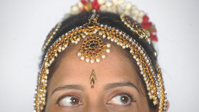 Rasmita Amin owns an Indian dance school and will be featured as the July/August Smart Woman.