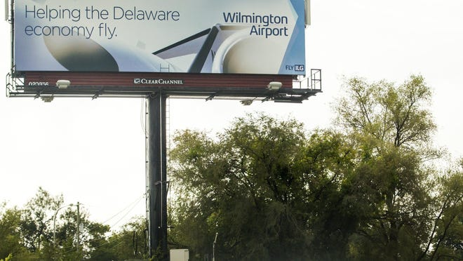 A billboard along Del. 141 in September 2015 shows new branding for Wilmington Airport in New Castle. Textron Aviation plans to cease operations of its aircraft maintenance at the airport.