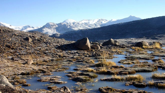 """Melting runoff from Peru's Quelccaya Glacier, in background, feeds high prairies before reaching farms and cities.Scientists have documented an """"accelerating retreat"""" of glaciers caused by warming temperatures that could pose serious water-supply problems."""