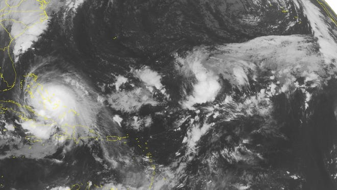 This NOAA satellite image taken Friday, October 02, 2015 at 12:45 AM EDT shows powerful Category 4 Hurricane Joaquin crawling through the Bahamas. Joaquin currently has maximum sustained winds of 130 miles an hour and will continue to affect the Bahamas over the next day. Some of the outer effects from Joaquin will affect Cuba where a Tropical Storm Warning is in effect for the northern coast of the Island. Squally weather can be expected over Cuba as well as the northern Caribbean. (Weather Underground via AP)