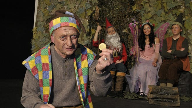 """Gilheany Odran plays Ruplestillskin shows off his coin in The Enchanted Playhouse puts on a Production of """"Ruplestillskin"""" on February 4, 2016."""
