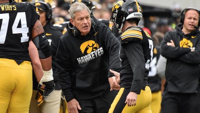 Iowa Hawkeyes head coach Kirk Ferentz (left) celebrates with placekicker Keith Duncan (3) after a field goal against the Purdue Boilermakers during the 2019 game at Kinnick Stadium.