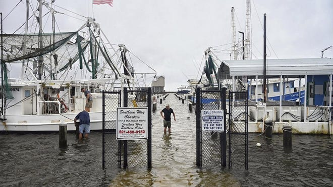 Fishermen secure their boats at Pass Christian Harbor on the Mississippi Gulf Coast ahead of Tropical Storm Cristobal's landfall, Sunday, June 7, 2020.