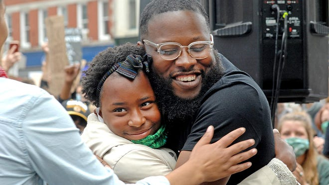"Najee Brown of Eliot hugs Amaya Conte, 11, also of Eliot, after Amaya gave a ""Black Lives Matter"" speech during the ""Portsmouth United: a Rally Honoring the Loss of Innocent Lives"" event Sunday in Market Square in Portsmouth."