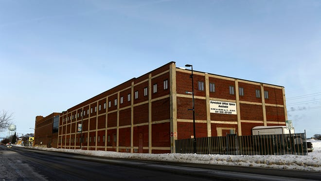 The Larsen Green property covers 15 acres and includes an old building that Walmart wanted to demolish, but that the city hopes to renovate.