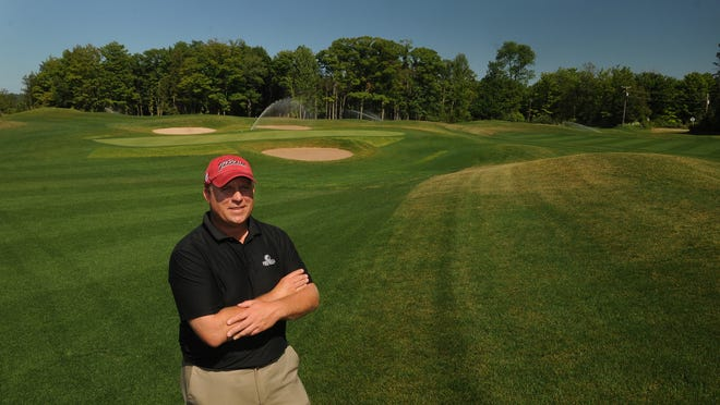 Jason Daubner, general manager of Peninsula State Park Golf Course in Ephraim, stands on a fairway of the new Short Course at Peninsula State Park, which is scheduled to open Thursday.