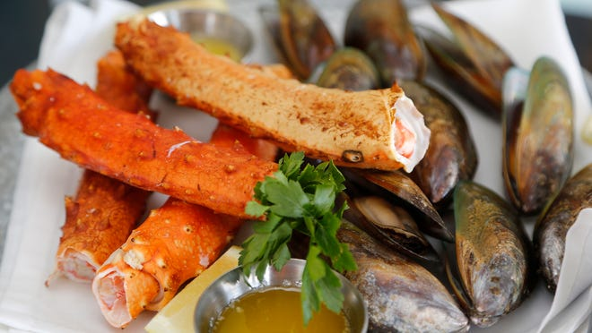 King crab and New Zealand green-lipped mussels are featured on the Seafood Tower at Parkside Seafood House – Oyster Bar. Parkside Seafood House – Oyster Bar acquires fresh clams, lobsters, crabs and other seafood from Chicago.
