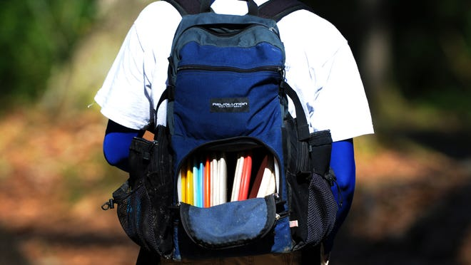 (Saturday, Jan. 2, 2009, photo by Denny Culbert/ dculbert@theadvertiser.com) Jose Ossa carries a backpack full of discs for every situation during the Mid-Winter Open Disc Golf Tournament Saturday at Acadiana Park in Lafayette. The event in its eleventh year was hosted by the Acadiana Disc Golf Association with divisions ranging from juniors to pro grand master. For more information about disc golfing locally visit http://www.fotojoeusa.com/ADGA/home.htm.