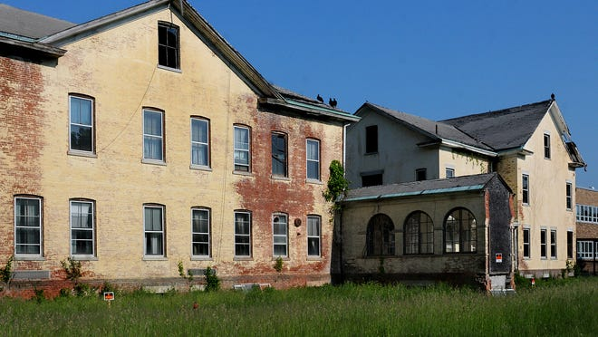 As vultures dry their wings on the roof of the former Dutchess County Infirmary in Millbrook, plans are in place to tear down the center wing, left, and supervisor's quarters, right, which are located adjacent to the Eastern Dutchess Government Center.