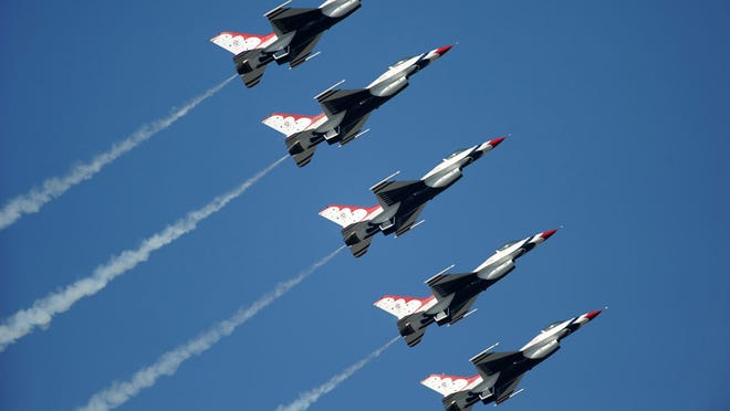 """The U.S. Air Force Air Demonstration Squadron """"Thunderbirds"""", perform the Line Abreast Loop during the Gulf Coast Salute and Open House Air show at Tyndall Air Force Base, Fla. Mar. 26, 2011. (U.S. Air Force Photo/Staff Sgt. Larry E. Reid Jr.)"""