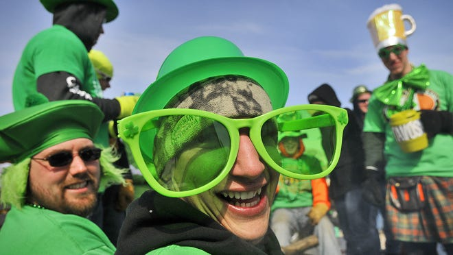 Dan Roeder, of St. Augusta, was seeing the world through giant green glasses while hanging out with friends at the 2011 St. Patrick's Parade in Marty.