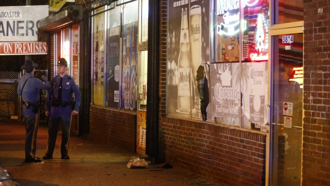 State police investigate Saturday night after a hit-and-run driver ran into a man who had just gotten out of his car and a restaurant where they were going, breaking its front window and leaving the driver facing a variety of charges.