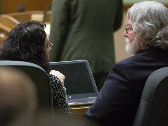 Francesca Estevez, left, sixth judicial district attorney, speaks with her attorney, Jim Foy, right, during a hearing at the Third Judicial District Court Friday, November 17, 2017.