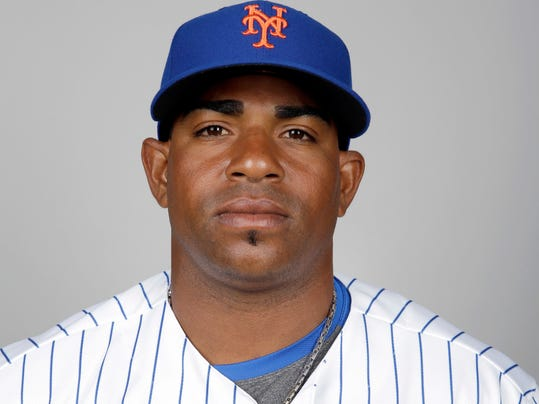 FILE - This is a 2016 file photo showing Yoenis Cespedes of the New York Mets baseball team. A person familiar with the negotiations says outfielder Yoenis Cespedes and the New York Mets have agreed to a $110 million, four-year contract. The person spoke on condition of anonymity Tuesday, Nov. 29, 2016, because the agreement is subject to Cespedes successfully completing a physical.  (AP Photo/Jeff Roberson, File)