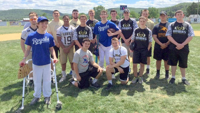 Members of the Corning Hawks football program volunteered to be buddies for the District 6 Little League Challenger Division game Sunday at Corning Little League field.