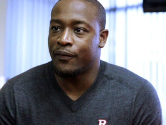 Coaches from the Rutgers football team were made available for the media interview at the Hale Center in Piscataway on Tuesday January 12, 2016. Here Rutgers football's new assistant defensive backs coach Aaron Henry talks with the media.