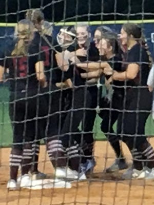 South Effingham freshman Bailey Kendziorski (wearing a face guard) is mobbed by her teammates after pitching a one-hitter in the Mustangs 1-0 victory over Effingham County on Sept. 15.