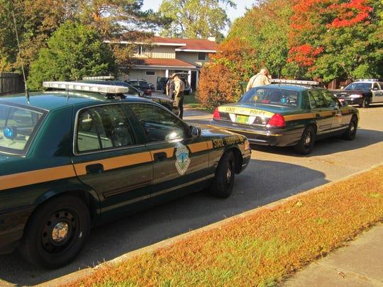 Vermont State Police cruisers line up along Surf Road in front of a home where a high-speed pursuit ended Sunday morning.