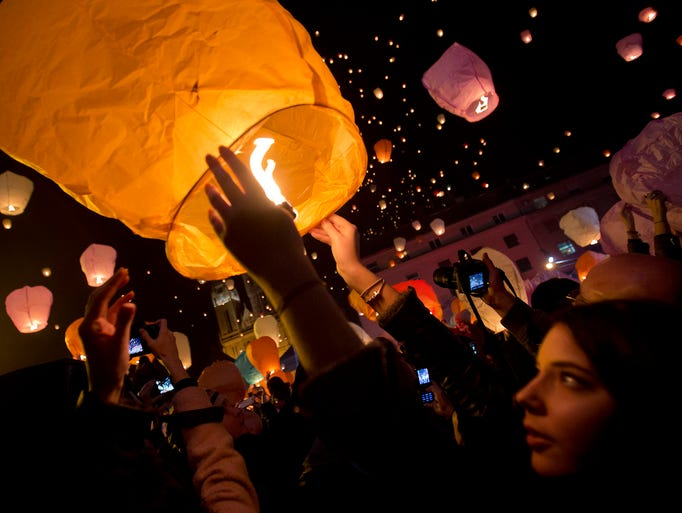 Paper lanterns are released during Christmas festivities