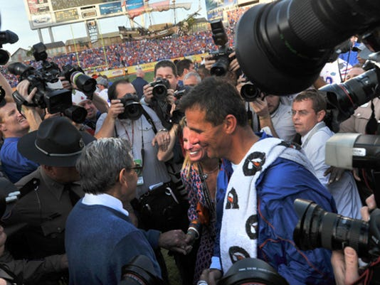 The media crowd around head coaches Joe Paterno and Urban Meyer after Penn State lost to Florida in the Outback Bowl on Jan. 1.  (York Daily Record/Sunday News - Jason Plotkin)