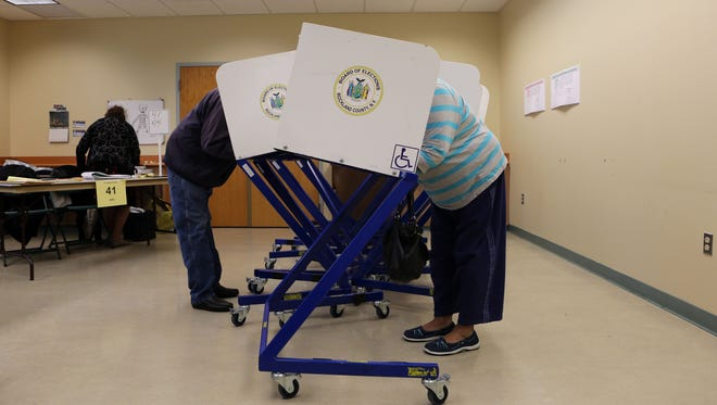 Beresford Robinson, left, of Nanuet and Halestine Phillips of Clarkstown vote at Pascack Community Center in Nanuet on primary day, April 19, 2016.