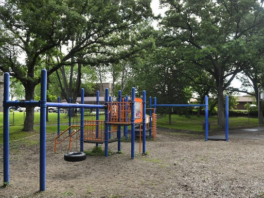 A tire swing, sling swings, and traditional playground