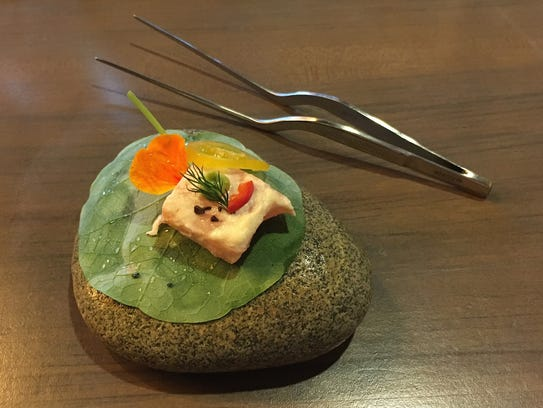 Pacific salmon is served atop an edible nasturtium