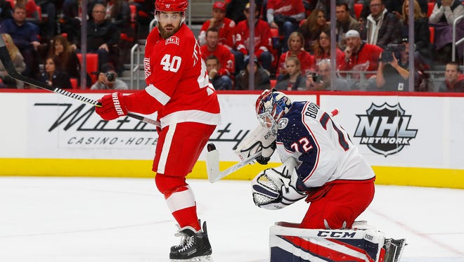 Blue Jackets goalie Sergei Bobrovsky (72) stops a shot as Red Wings center Henrik Zetterberg (40) looks for the rebound in the second period on Saturday, Nov. 11, 2017, at Little Caesars Arena.