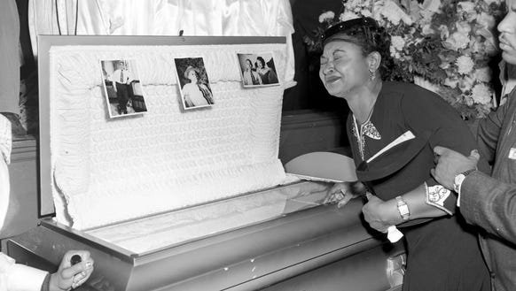 In this 1955 file photo, Mamie Till Mobley weeps at